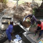 The Water Project: Luyeshe Community, Khausi Spring -  Setting The Tiles