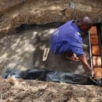 The Water Project: Luyeshe Community, Khausi Spring -  Brick Setting And Measurement