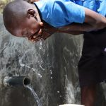 The Water Project: Luyeshe Community, Khausi Spring -  Edwin Enjoying The Clean Water