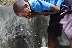 The Water Project:  Edwin Enjoying The Clean Water