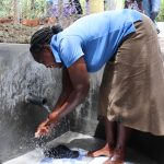 The Water Project: Luyeshe Community, Khausi Spring -  Esther Washing Her Hands At The New Spring