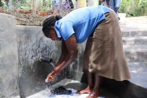 The Water Project:  Esther Washing Her Hands At The New Spring