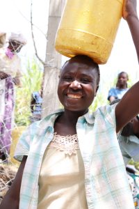 The Water Project:  Madam Naliaka Happy To Fetch Clean Water