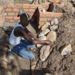The Water Project: Indulusia Community, Osanya Spring -  Arranging The Stones For Pitching