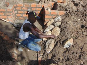 The Water Project:  Arranging The Stones For Pitching