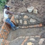 The Water Project: Indulusia Community, Osanya Spring -  Plastering The Stone Pitching