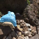 The Water Project: Indulusia Community, Osanya Spring -  Backfilling With Stones