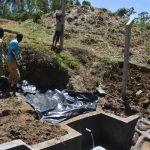 The Water Project: Indulusia Community, Osanya Spring -  Backfilling With Tarp