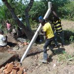 The Water Project: Indulusia Community, Osanya Spring -  Erecting The Fence Poles