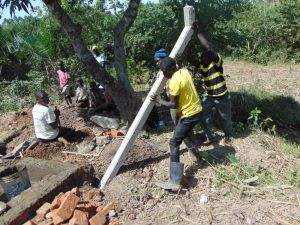 The Water Project:  Erecting The Fence Poles