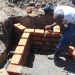 The Water Project: Indulusia Community, Osanya Spring -  Wall Construction