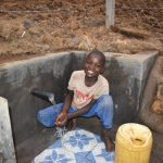 The Water Project: Indulusia Community, Osanya Spring -  Evason Enjoying Clean Water