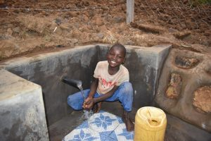 The Water Project:  Evason Enjoying Clean Water