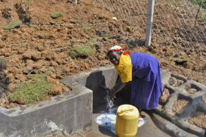 The Water Project:  Mama Osanya Enjoying Clean Flowing Water