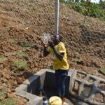 The Water Project: Indulusia Community, Osanya Spring -  Enjoying Clean Water