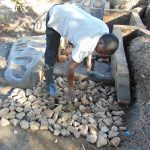 The Water Project: Makhwabuyu Community, Sayia Spring -  Setting The Foundation For The Stairs