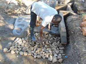 The Water Project:  Setting The Foundation For The Stairs