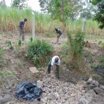 The Water Project: Makhwabuyu Community, Sayia Spring -  Backfilling With Stones