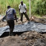 The Water Project: Makhwabuyu Community, Sayia Spring -  Laying The Tarp