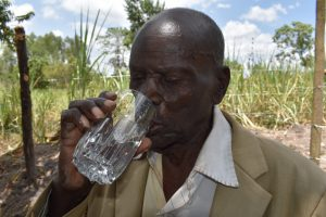 The Water Project:  Boniface Drinking Water From The Protected Spring