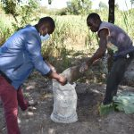 The Water Project: Makhwabuyu Community, Sayia Spring -  Filling The Sack With Soil For Kitchen Gardening