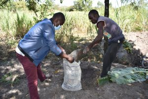 The Water Project:  Filling The Sack With Soil For Kitchen Gardening