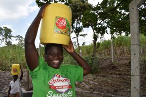 The Water Project:  Irene Taking Water Home