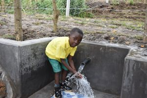 The Water Project:  Simon Playing With Water