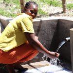 The Water Project: Makhwabuyu Community, Sayia Spring -  Enjoying Flowing Water