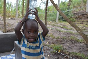 The Water Project:  Little Boy Carrying Water