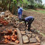 The Water Project: Mukhonje B Community, Peter Yakhama Spring -  Arranging The Stone Pitching