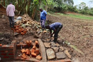 The Water Project:  Arranging The Stone Pitching