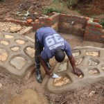 The Water Project: Mukhonje B Community, Peter Yakhama Spring -  Plastering The Stone Pitching