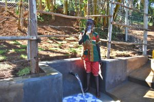 The Water Project:  Alex Drinking Clean Water