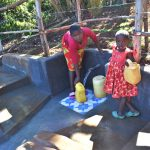The Water Project: Mukhonje B Community, Peter Yakhama Spring -  Fetching Water From The Protected Spring