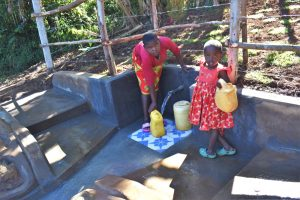 The Water Project:  Fetching Water From The Protected Spring