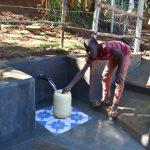 The Water Project: Mukhonje B Community, Peter Yakhama Spring -  Joseph Fetching Water