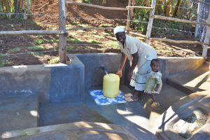 The Water Project:  Josphine And Her Daughter Fetching Water