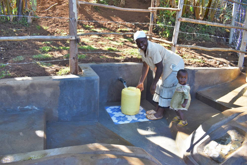 The Water Project : kenya21053-josphine-and-her-daughter-fetching-water