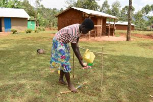 The Water Project:  Practicing Handwashing Using A Tippy Tap
