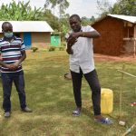 The Water Project: Mukhonje B Community, Peter Yakhama Spring -  Trainer Victor Watches A Man Practice Handwashing