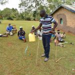 The Water Project: Mukhonje B Community, Peter Yakhama Spring -  Victor Shows How To Build A Tippy Tap