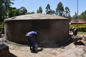 The Water Project:  Working On Tank Skirting