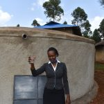 The Water Project: Friends Musiri Secondary School -  Teacher Celebrating Water On Campus