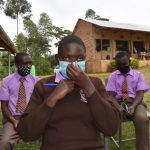 The Water Project: Friends Musiri Secondary School -  Adjusting A Mask At Training