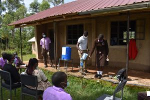 The Water Project:  Wetting A Toothbrush During Dental Hygiene Session