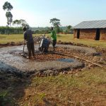 The Water Project: Mwikhupo Primary School -  Pouring Concrete Foundation