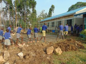 The Water Project:  Students Help Place Wire Over Foundation