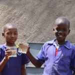 The Water Project: Mwikhupo Primary School -  Becky And Christopher Saying Cheers To Clean Water