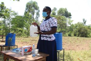 The Water Project:  Constructing Handwashing Leaky Tin